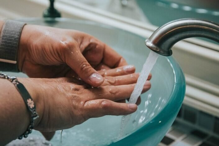 washing hand in a raised sink
