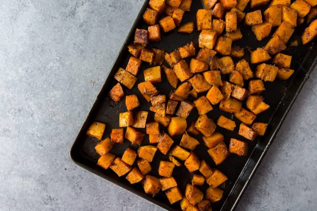 Roasted squash out of the oven on a cookie sheet