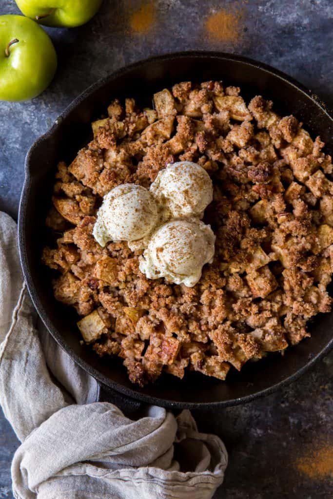 A close up of the keto apple crisp with ice cream