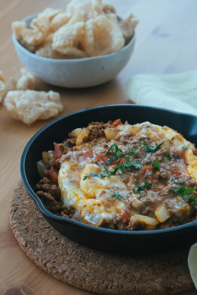 Our Easy keto Taco Dip uses the combination of a brie cheese wheel and delicious seasoned meat to give you the perfect, low carb appetizer!