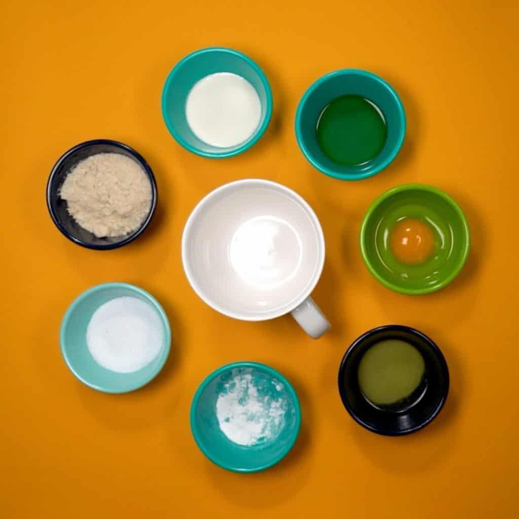 ingredients in small bowls being added to a coffee mug