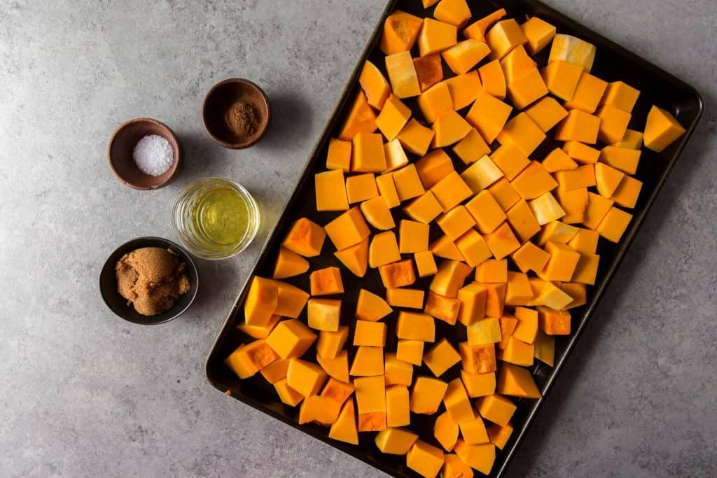 Ingredients to the left of freshly cut squash