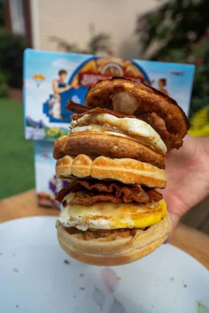 two kete breakfast sandwiches being held stacked on top of each other