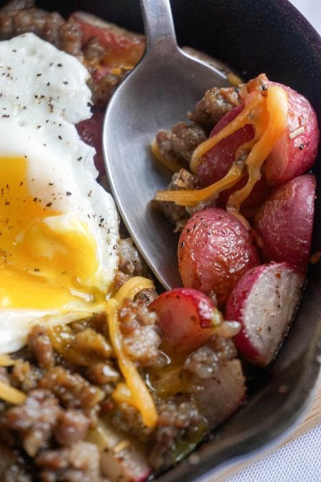 Keto Breakfast Bowl! Perfectly roasted radishes topped with sausage, cheese and a perfectly cooked egg!