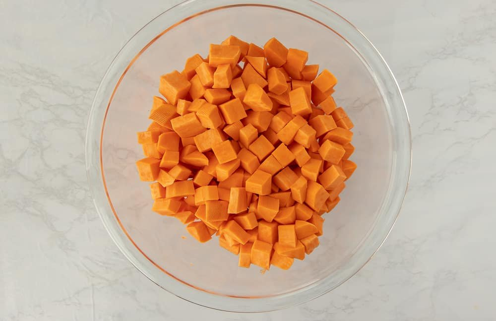 Glass bowl of diced sweet potatoes