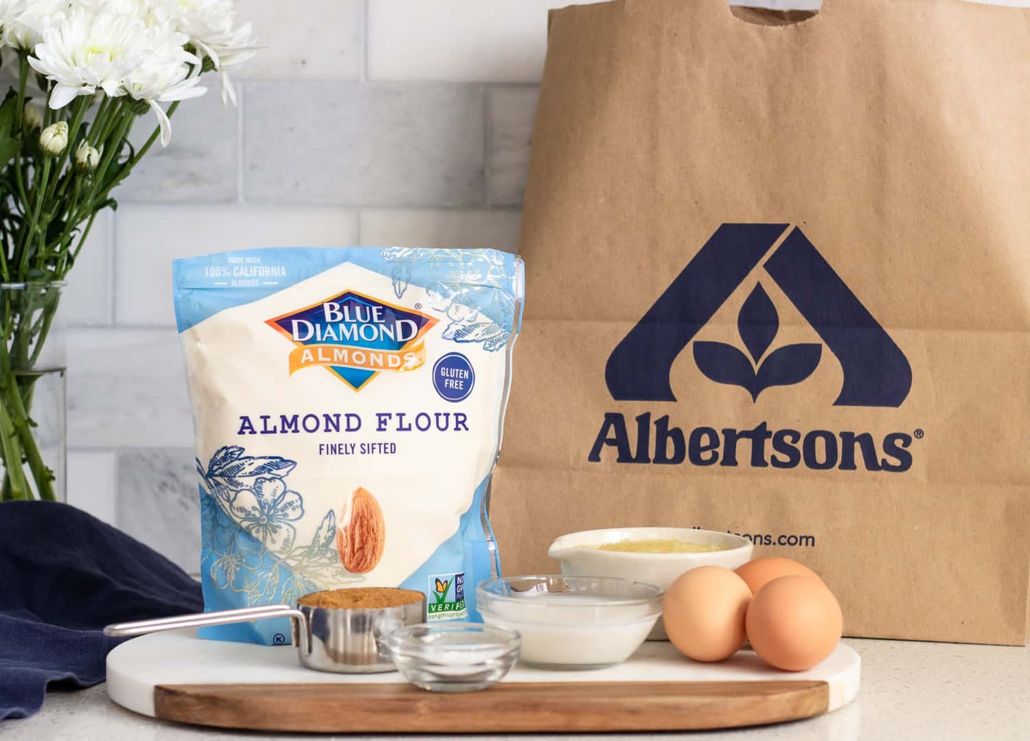 Albertson's paper bag in the background and Blue Diamond Almond Flour package with other ingredients.