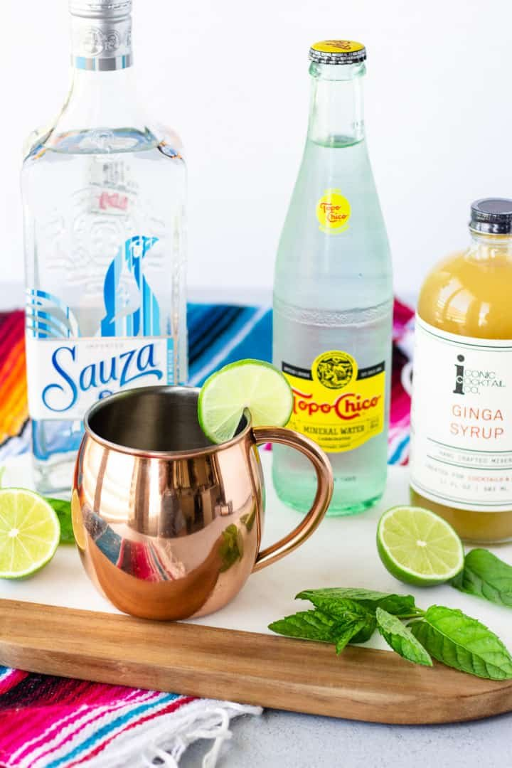 Ingredients for cocktail- Tequila, Topo Chico, Ginga Syrup, lime, and mint leaves.