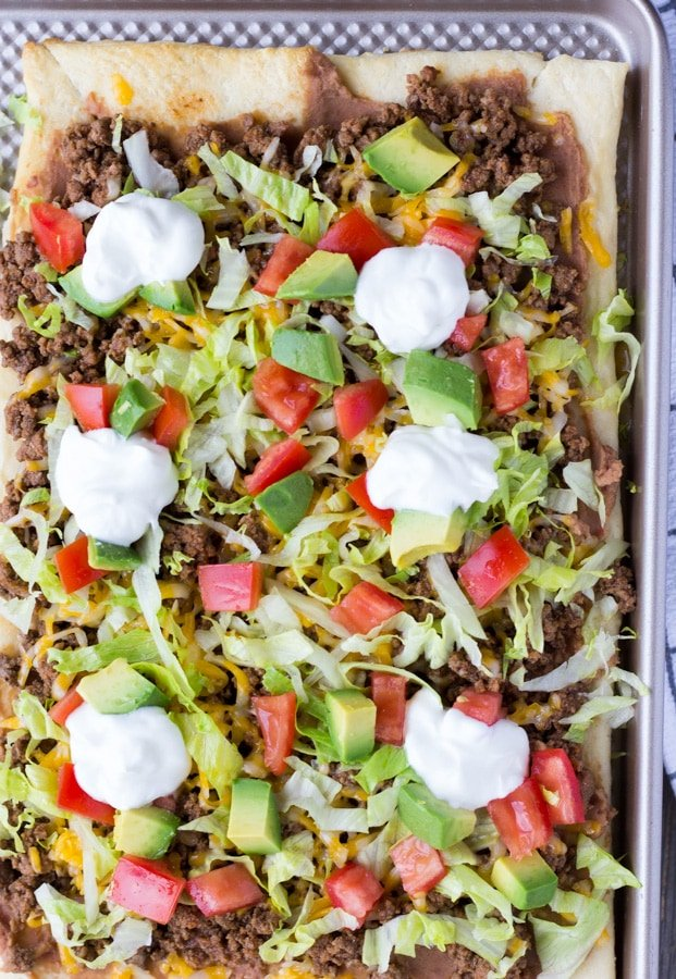 Overhead view of Crescent Dough Taco Pizza on a baking sheet.