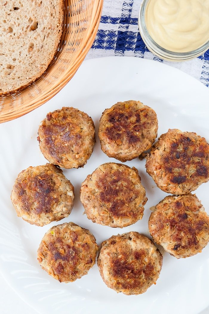 german meatballs on plate with bread in basket and mustard behind