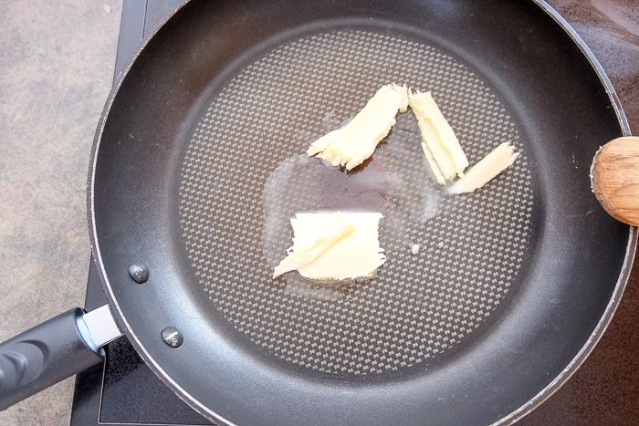 butter melting in frying pan on stove top