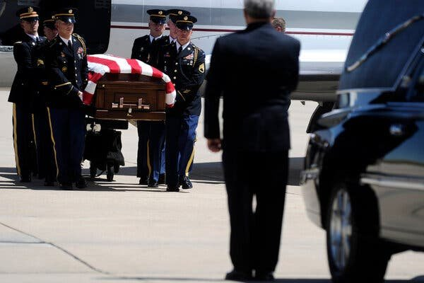 The coffin of Army National Guard Chief Warrant Officer David R. Carter was carried to a waiting car at Buckley Air Force Base in Denver in August 2011. He was among the 30 servicemen who died when a Chinook helicopter was shot down in Afghanistan.