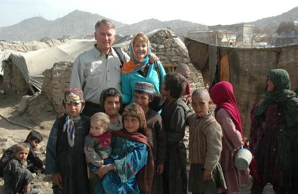 Lt. Gen. John A. Bradley, who retired from the military in 2008, and his wife, Jan, at a displaced persons camp in Kabul in March 2010.