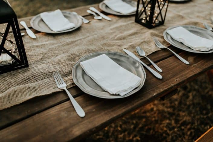 stainless steel plates at wooden table