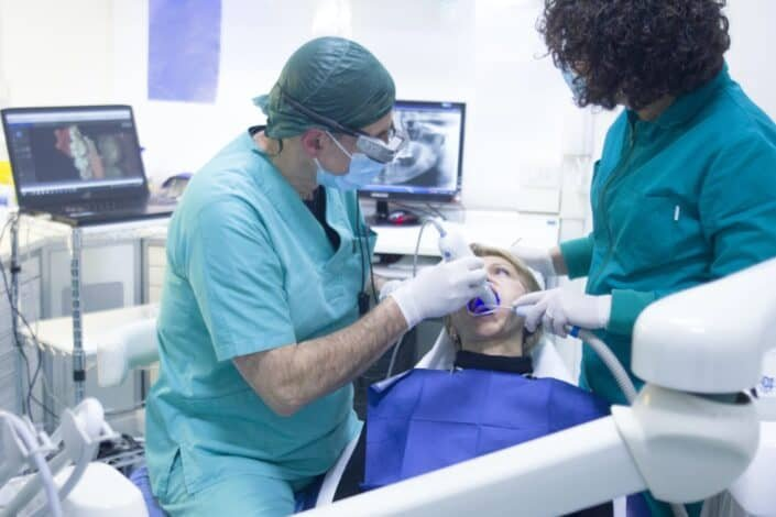 dentist and assistant doing a dental procedure