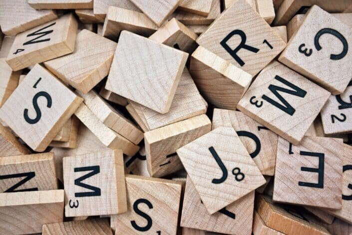 A pile of lettered scrabble tiles