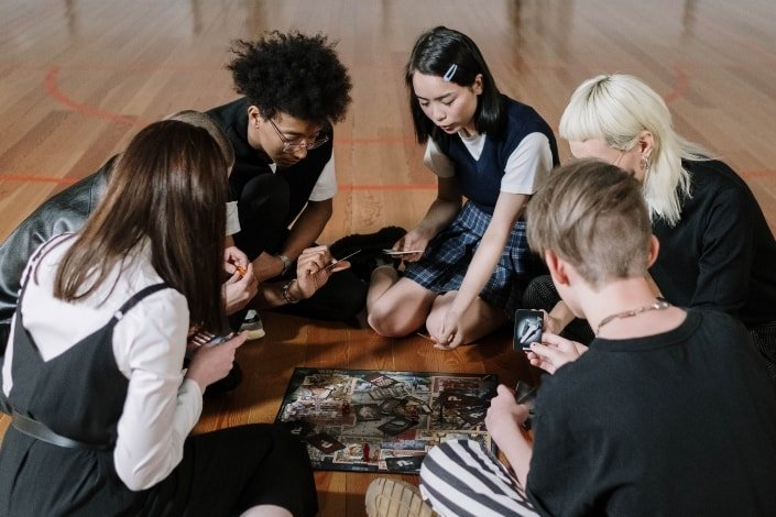 group of friends playing a card game