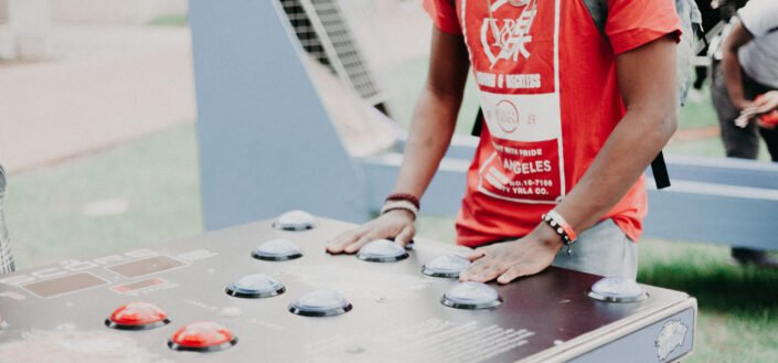 man with hands on a game table