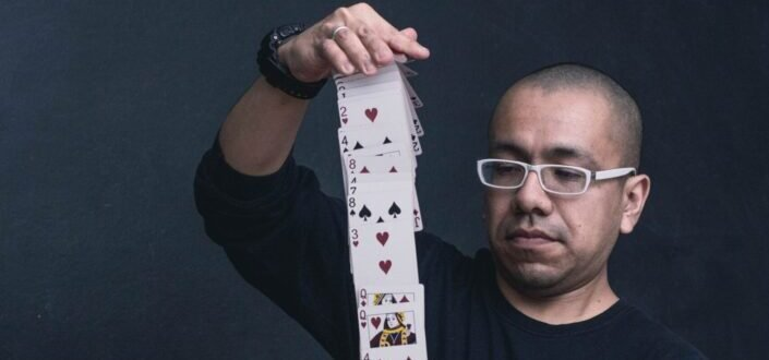 man playing with a deck of cards