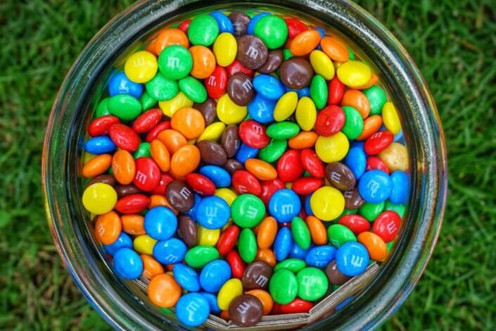 M&Ms on a glass container