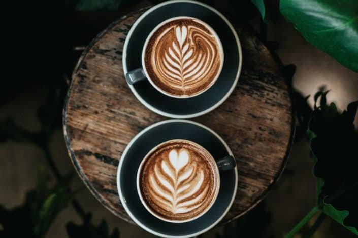 Two mugs with Latte art