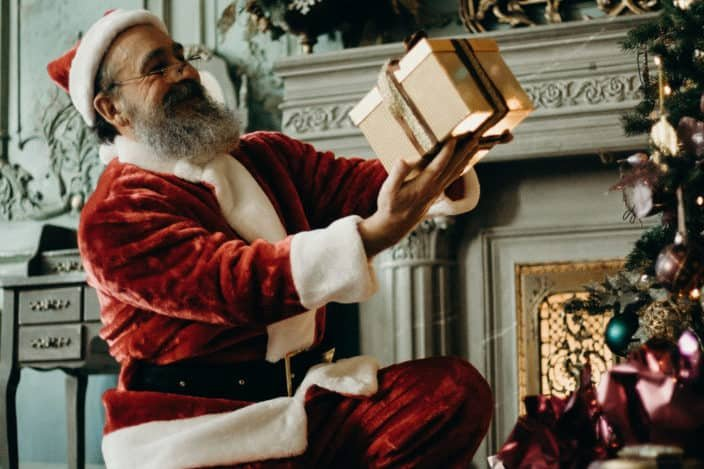 funny Christmas puns - Why does Santa Claus go down the chimney on Christmas Eve? Because it soots him.jpg