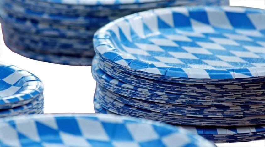 a stack of blue and white paper plates