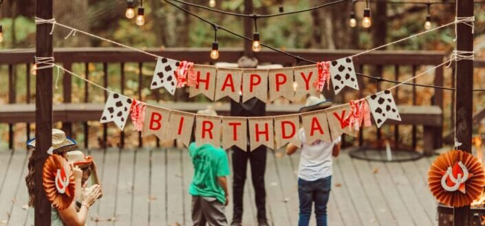 """a banner with """"Happy Birthday"""" written on it"""