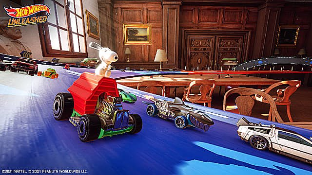 Snoopy car racing a shark car, Delorean, and others on a blue track in a study.